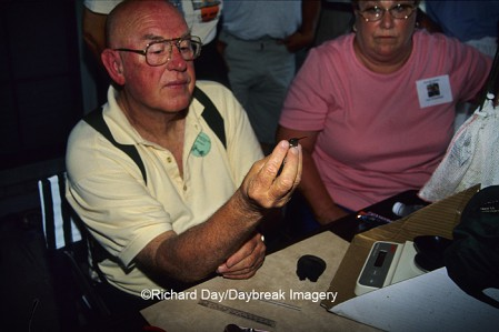 Bob & Martha Sargent banding hummingbird at Rockport TX Hummer-Bird Celebration